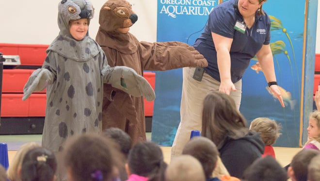Students at Aumsville Elementary school learn about aquatic mammals during a visit by the Oregon Coast Aquarium's education team.