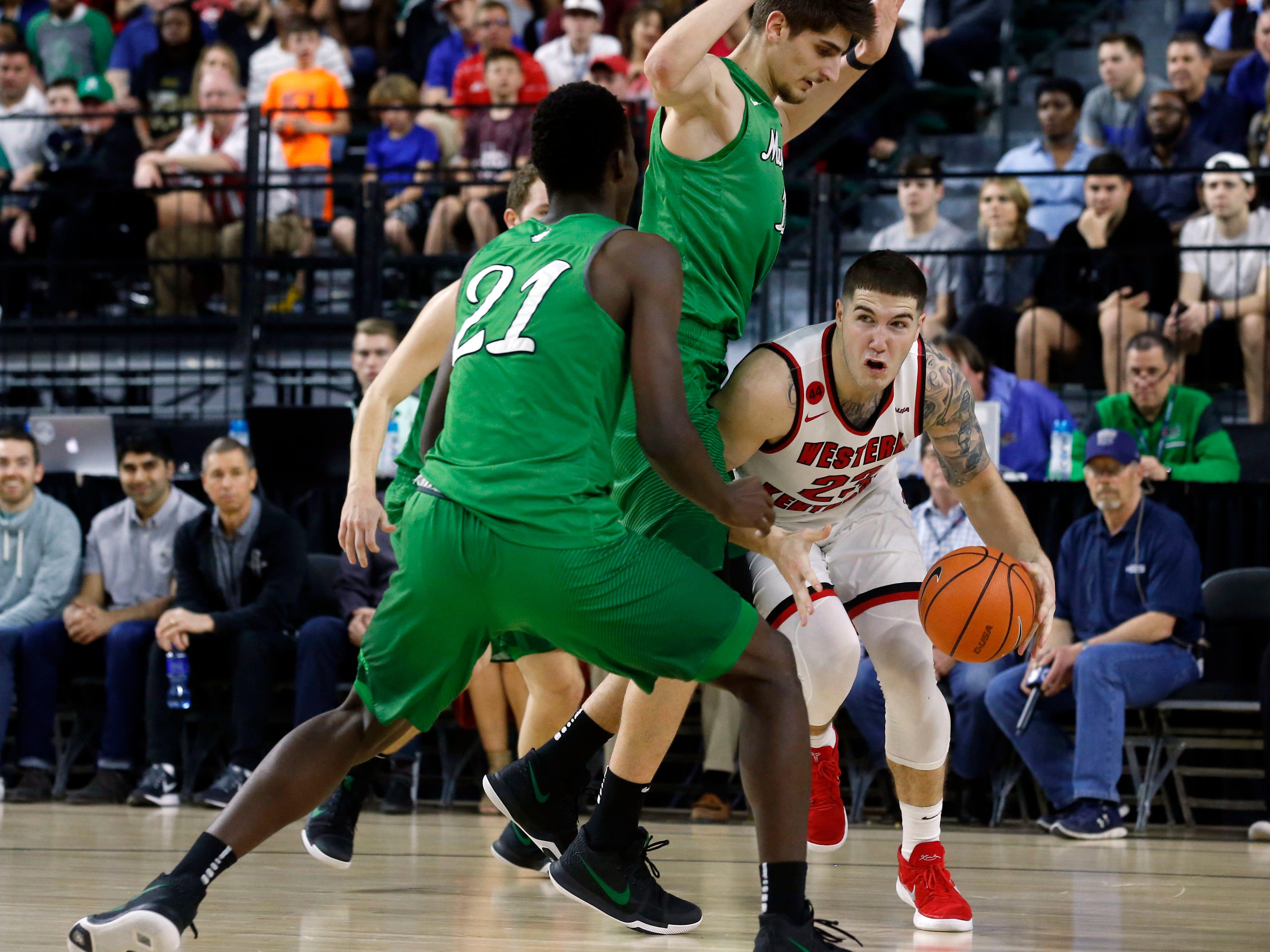 Marshall forward Darius George (21) and forward Ajdin Penava (11) defend Western Kentucky forward Justin Johnson (23) during the first half of the NCAA Conference USA Men's Basketball Championship Game in Frisco, Texas, Saturday, March 10, 2018. (AP Photo/Michael Ainsworth)