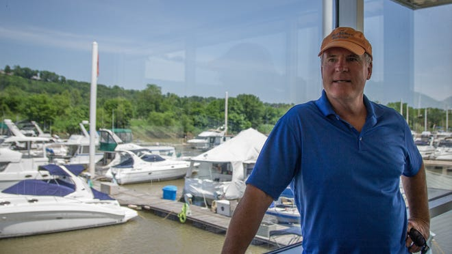 Developer David Imboden, owner of DCI Properties-DKY, stands in the Manhattan Harbour Marina clubhouse. Imboden bought the marina Tuesday and plans to build an entertainment district and rental housing.