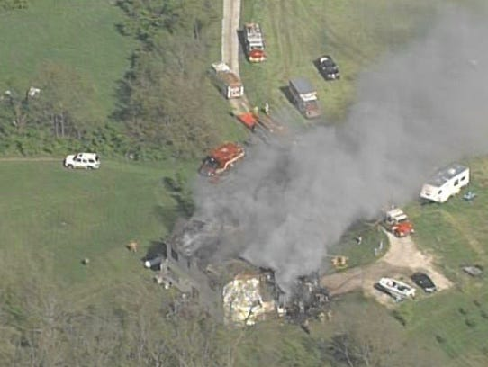 Several fire crews battle a large house fire on Snyder