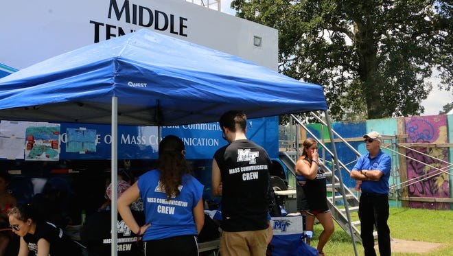 MTSU student workers gather behind the university's Mobile Production Lab parked alongside the Who Stage at this year's Bonnaroo Music and Arts Festival.