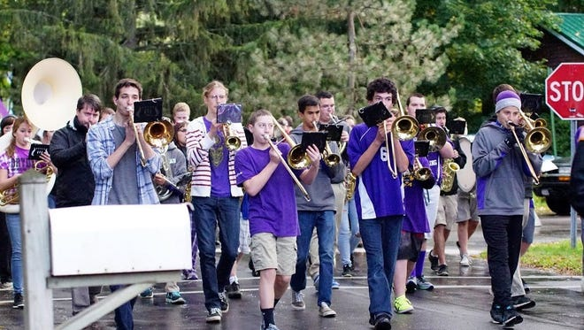 Dryden high school's marching band at last year's Homecoming Parade.