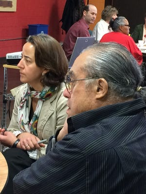 Andi Crawford, a neighborhood resource coordinator for the city of Lansing and Margarito Garcia III, a retired teacher and college instructor, discuss age-friendly communities Wednesday at the Allen Neighborhood Center.