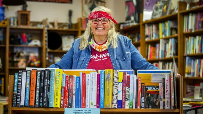 Susan Post poses Tuesday at her store, BookWoman, in North Austin. Post is the only bookseller to have participated in every Texas Book Festival. The fest is celebrating 25 years this year, and BookWoman has been in business for 45 years.