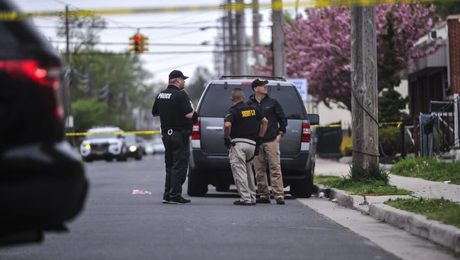 Police at the seen of a shooting between 44-46 Ridge Ave in Asbury Park on May 6, 2018.