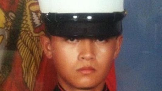 A photo of the late Marine Allan DeVillena II. He was shot by police in 2012. A second witness said police shot his car as he drove away.