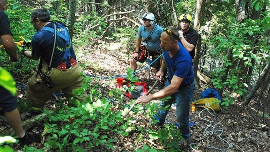 Ephraim firefighters clear a path so emergency responders can evacuate an injured Porterfield woman who fell from a ledge near Ellison Bluff County Park on Saturday.