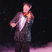 Shoji Tabuchi plays country music during a recent performance.