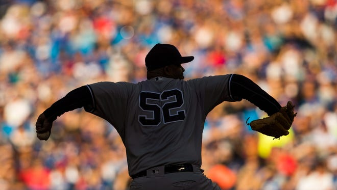 New York Yankees pitcher CC Sabathia pitches against the Toronto Blue Jays during the seventh inning of a baseball game in Toronto, Saturday, Sept. 24, 2016.
