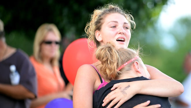 Kaitlin Gray embraces her niece, Kristen Janes, as they reunite at the evacuation center at Timberline Church in Fort Collins on Saturday, Sept. 14, 2013. Janes was evacuated from Drake on Saturday, along with her grandparents whose home beside the Big Thompson River was destroyed in the flood.