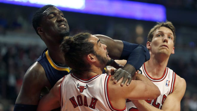 Chicago Bulls' Joakim Noah and Mike Dunleavy battle for rebound position against Indiana Pacers' Roy Hibbert in the 1st quarter at the United Center in Chicago on Monday, March 24, 2014, in Chicago. (Scott Strazzante/Chicago Tribune/MCT)