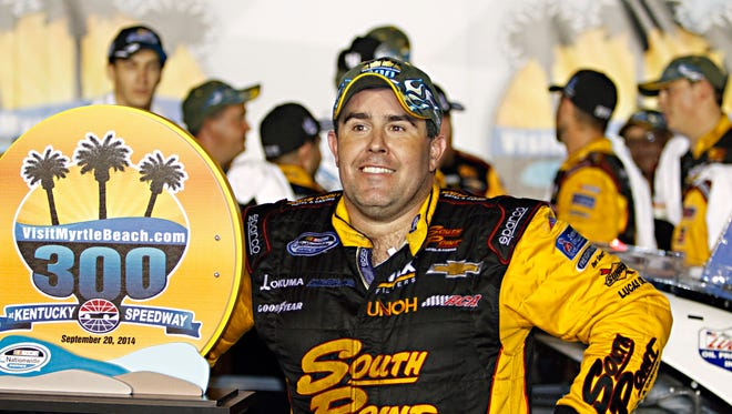 Driver Brendan Gaughan smilesas he talks about his come-from-behind victory in the NASCAR Nationwide auto race in Sparta, Ky., Saturday, Sept. 20, 2014.