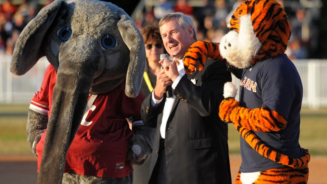 Montgomery mayor Todd Strange welcomes Big Al and Aubie to town for the Auburn-Alabama softball game at Lagoon Park in Montgomery, Ala. on Wednesday night April 16, 2014.