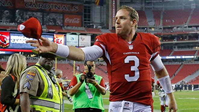 Cardinals quarterback Carson Palmer leaves the field after their loss to the Bengals in a preseason game on Aug. 24, 2014.