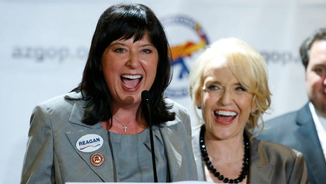Republican Michele Reagan celebrates her nomination in the GOP primary for Secretary of State Tuesday night. Behind her is Gov. Jan Brewer.