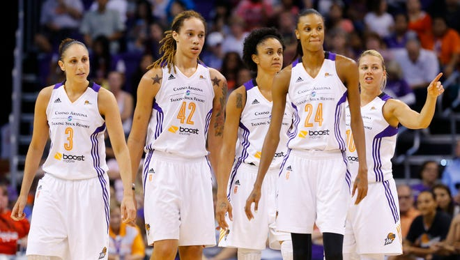 Phoenix Mercury's  Diana Taurasi, Brittney Griner  Candice Dupree (4) DeWanna Bonner (24)  and Anete Jekabsone-Zogota against the Chicago Sky during the second half of  their WNBA game  Wednesday, July 2,, 2014 in Phoenix, Ariz.  Dupree led with 26 points and 14 rebounds.