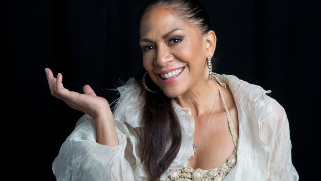 "Sheila E poses for a portrait in support of her new album ""The Beat of My Own Drum"" released, Tues., Sept. 2, 2014 in New York. The musician's memoir released through Simon & Schuster's Atria Books, features stories about working with Marvin Gaye, Ringo Starr and Lionel Richie to being raped at age five. Sheila E. said dating Prince and Santana made her realize she had a thing for guys with guitars."