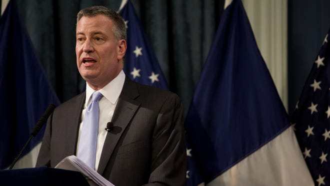 New York Mayor Bill de Blasio delivers his budget address at City Hall in New York Wednesday, Feb. 12, 2014. De Blasio unveiled his first budget proposal Wednesday, revealing that the nationâ??s largest city has a surplus but warning that it still faces stark fiscal challenges due to the expired labor contracts by all 150 municipal unions.