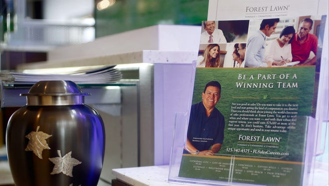Former Major League Baseball pitcher Fernando Valenzuela is pictured on the cover of a Forest Lawn promotional flyer at the Glendale Galleria mall in Glendale, Calif.