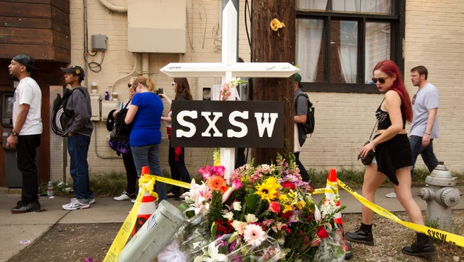 A cross and flowers are set up outside The Mohawk nightclub March 15, 2014, in Austin, Texas, as a memorial to the two victims of a hit-and-run tragedy at the South by Southwest music festival.