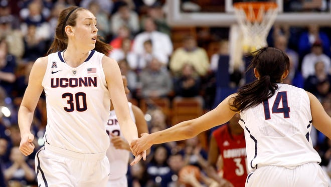 Connecticut Huskies forward Breanna Stewart, left, and guard Bria Hartley react after a play as they take on the Louisville Cardinals.