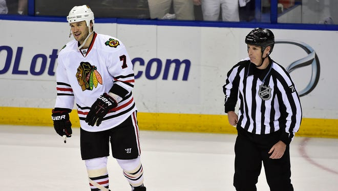 Chicago Blackhawks defenseman Brent Seabrook heads off the ice after being ejected for charging St. Louis Blues captain David Backes.