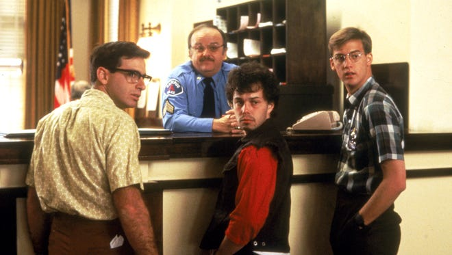 """Robert Carradine, left, Curtis Armstrong and Anthony Edwards starred in """"Revenge of the Nerds,"""" which turns 30 this year."""
