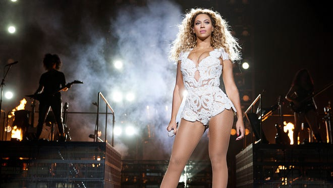 Beyonce strikes a pose while performing in New Zealand. She's one of many artists donating a song to aid relief efforts in the Philippines.