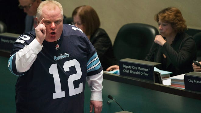 Mayor Rob Ford speaks to city council members about new allegations against him in Toronto on Nov. 14, 2013.