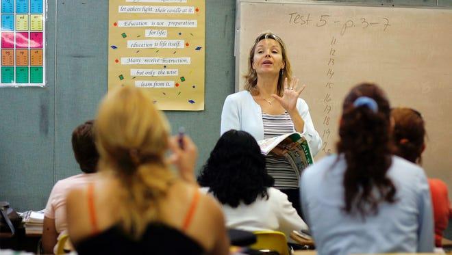 MIAMI - JUNE 16:  English teacher Radka Tomasek speaks to the class at the English Center June 16, 2006 in Miami, Florida.