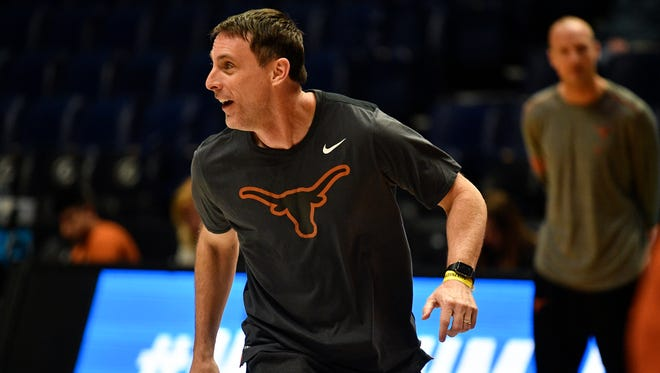 Texas assistant coach Darrin Horn runs with his team during a practice session Thursday at Bridgestone Arena.