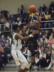 Avoyelles Charter's Aaron McGhee (1) shoots over Menard's Jourdain Dishmond Jan. 30. McGhee was named as the District 4-2A MVP by the district's coaches.