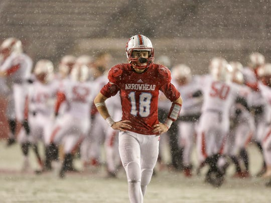 Arrowhead's Tyler Jones reacts after Kimberly defeated Arrowhead, 49-42, in the WIAA Division 1 high school football championship game Friday, Nov. 20, 2015.