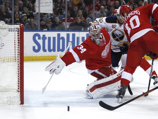 """Petr Mrazek battles. """"He saves a lot with his stick coming back when he is out of the net,"""" Gustav Nyquist said."""