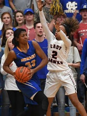 South Side's MaKayla Transou guards McNairy's Khyla Wade-Warren during the district 14-AA Girls Championship game, Monday, Feb. 19. McNairy defeated South Side, 70-55, to become the District 14-AA Girls Champion.