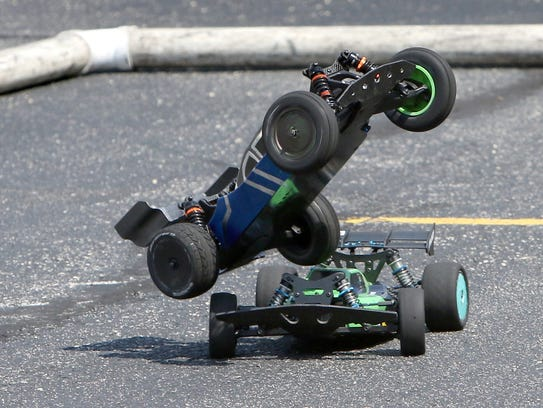A remote control vehicle goes airborne when it collided