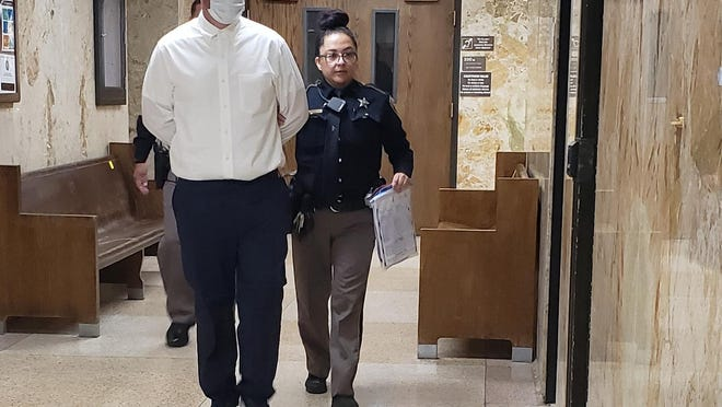 Lubbock County sheriff's deputies escort Jordan Mansel out of the 137th District Court after he pleaded guilty to an aggravated assault charge in connection with a fatal 2015 wreck.