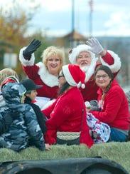 Santa and Mrs. Claus arrive at Winterfest at Klien