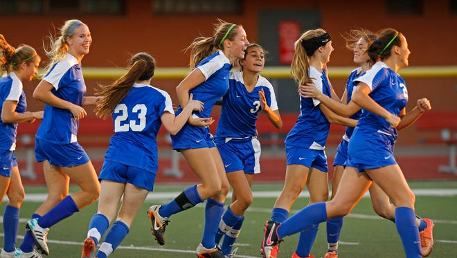 Fountain Hills Leah Carillo, center, is greeted by teammates after she scored against Northwest Christian in their Division III girls soccer semifinal match  at Arcadia High School Tuesday, Feb.10, 2015 in Phoenix.