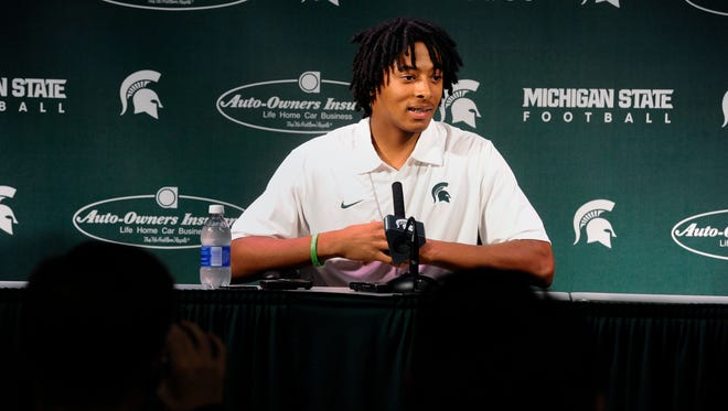 Injured MSU football player Jalen Watts-Jackson speaks to reporters in East Lansing  Wednesday October 22, 2015 about his game-winning touchdown run and the teammates who blocked for him  on a late fumble recovery against Michigan last Saturday night.  Watts-Jackson fractured and dislocated his hip scoring the game-winning touchdown.