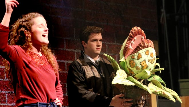 "The Audrey II continues to grow from special feeds by Seymour (Dylan Hoppel) in the Kettle Moraine Performs' production of ""Little Shop of Horrors. Show dates are Feb. 22 and 23 at 7 p.m., and 1 p.m. and 7 p.m. on Feb. 24 at Kettle Moraine High School."