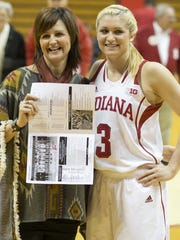 Tyra Buss poses for a photo with her fifth grade school teacher Julie Richison, Mt. Carmel, Ill.. Richison and several other of Buss' teachers made the trip to see the standout play.