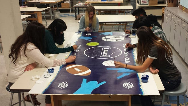 Students in the advance studio art class designed the mural for Boys and Girls Club.