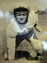Former CSU football player Gary Glick, shown in photo displayed at his home in 2014, was picked No. 1 overall in the 1956 NFL draft by the Pittsburgh Steelers and played seven seasons in the NFL. He is one of several notable players in school history to wear No. 12.