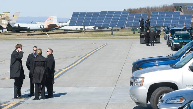 Secret Service and security teams prepare for President Barack Obama's arrival at Burlington International Airport in 2012. Secret Service agents will return to Burlington on Thursday to provide protection for Republican presidential candidate Donald Trump.