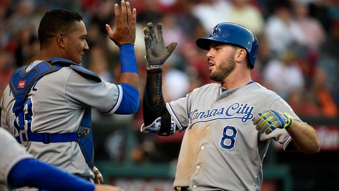 Royals third baseman Mike Moustakas celebrates with catcher Salvador Perez after a home run in the fourth inning.