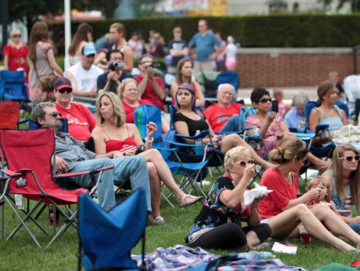 Concert goers watch a jazz band during last year s carmelfest photo
