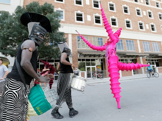 Performance artists walk the streets at Chalk the Block
