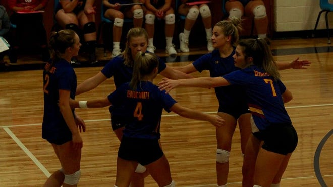 Benson County players celebrate after a point in a game against St. John on Sept. 24 at Leeds High School. The Wildcats won 3-0.