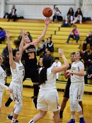 Going hard through the lane against Dearborn Heights Crestwood is Belleville standout Katelyn Sherwood (30). She scored 20 points in the Feb. 2 contest, including 12 in the fourth quarter.